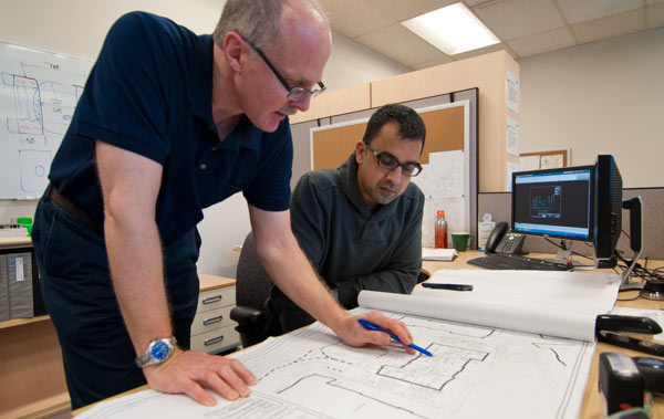 Engineers reviewing drawings - copyrighted